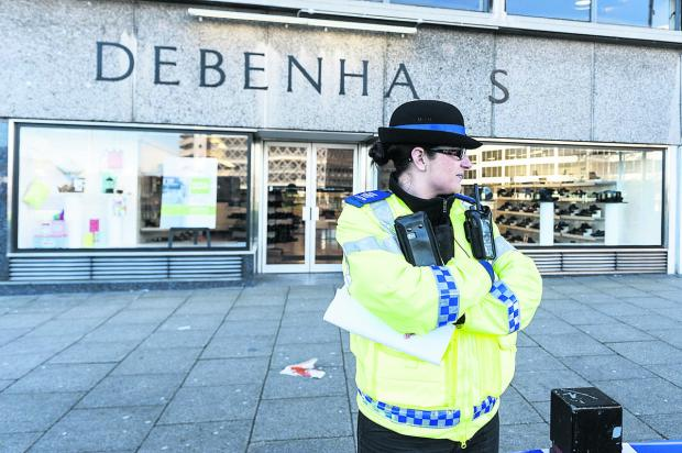 This Is Wiltshire: Police presence outside Debenhams on Fleming Way following the sexaul assault of a woman last month