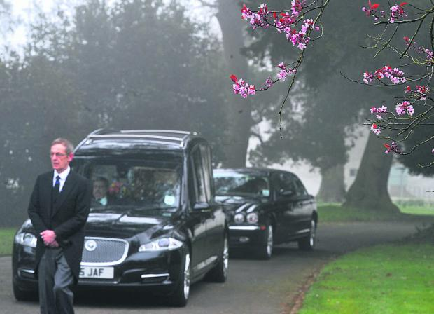 This Is Wiltshire: Gary Savory's coffin arrives at his funeral yesterday