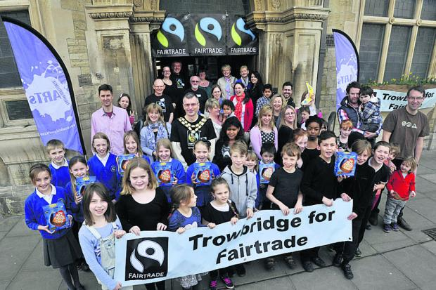 This Is Wiltshire: Trowbridge Fairtrade Group with youngsters from Hilperton Primary School and Walwayne Court Primary School at their event at the Town Hall