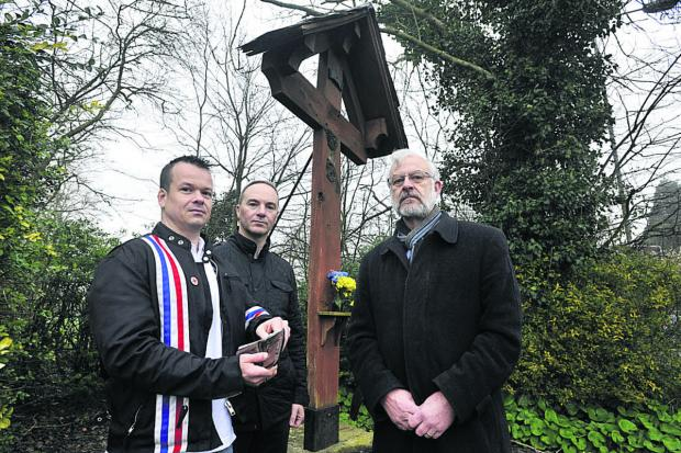 This Is Wiltshire: Michael Copland-Griffiths, right, with Neil White, left,  and Dominic Hayhoe from Forces War Records who are offering a reward for the   return of the stolen statue