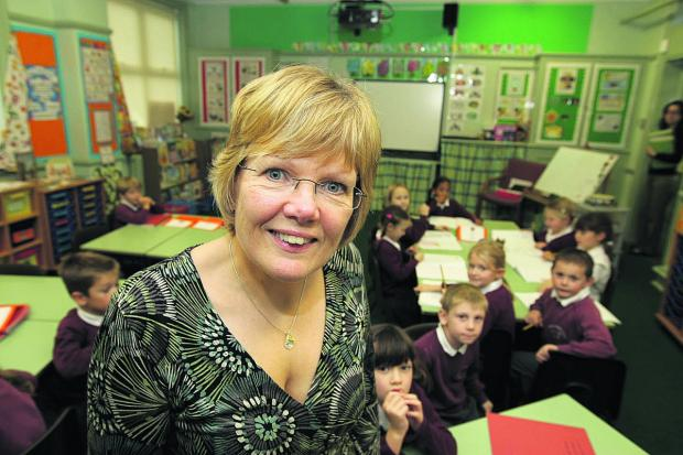 This Is Wiltshire: Headteacher Jan Thomas pictured with pupils