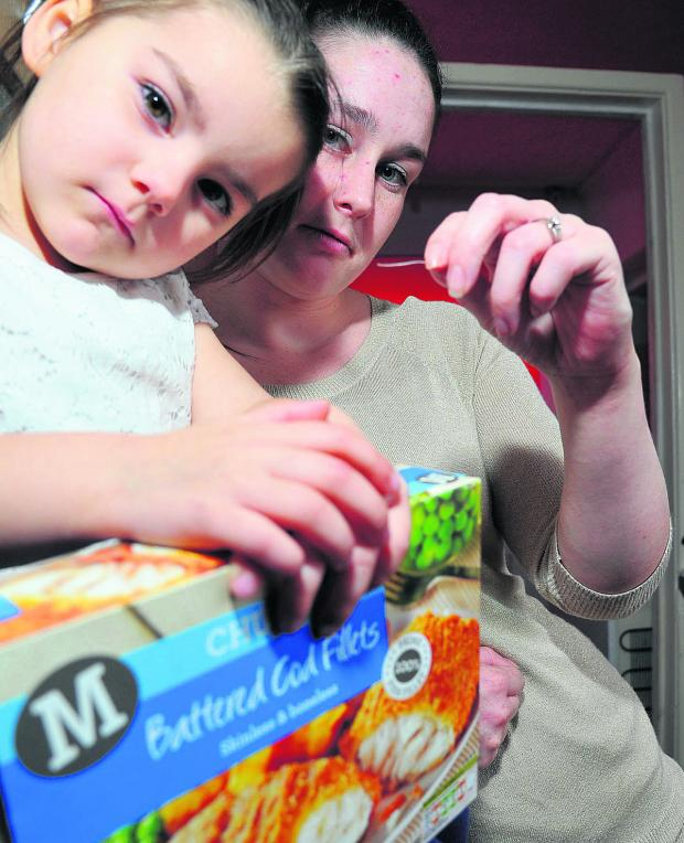 This Is Wiltshire: A fish bone measuring 1.5in got stuck in the mouth of Kara Moore aged four, pictured with mum April