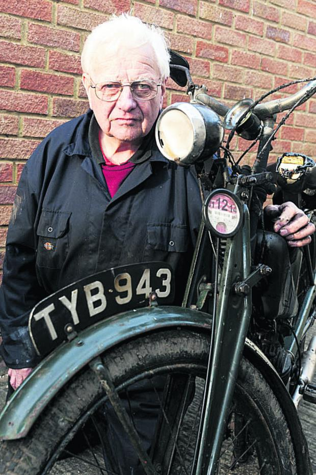 This Is Wiltshire: Dennis Iles with one of his burnt out bikes