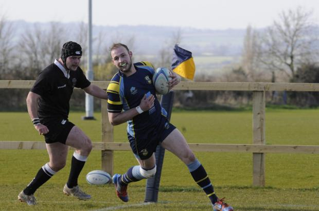 This Is Wiltshire: Ashley Chalk goes over for a try for Trowbridge against Wimborne