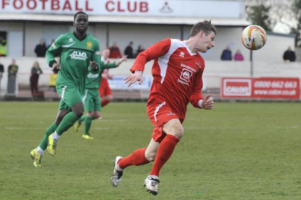 This Is Wiltshire: Frome Town's Ricky Hulbert, pictured in the Robins' kit bearing t
