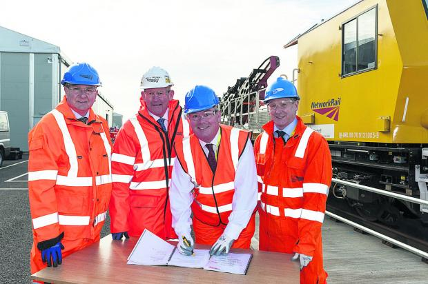This Is Wiltshire: Signing the contract, from left, Steve Wright and Bill Henry, of Network Rail, Stephen Trotter, of ABB, and Stewart Dawson, of UKPN Services. Picture: Alex Skennerton