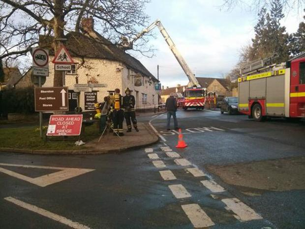 This Is Wiltshire: Firefighters at The Rattlebone Inn this morning. Picture by BBC Wiltshire