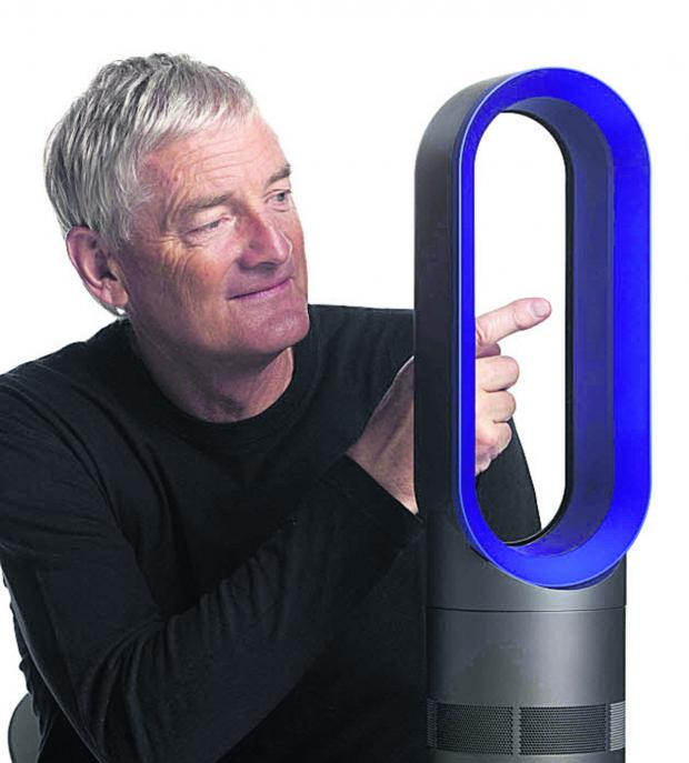 This Is Wiltshire: Sir James Dyson with an AM04 fan. The company is recalling all AM04 and AM05 bladeless fans over fears they could pose a fire risk