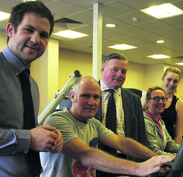 This Is Wiltshire: Jonathan Seed, Wiltshire Council cabinet member for leisure, centre, with Devizes Leisure Centre manager Dan Webb, left, and gym users Keith Moore, Anna Villette and Elyne Williams
