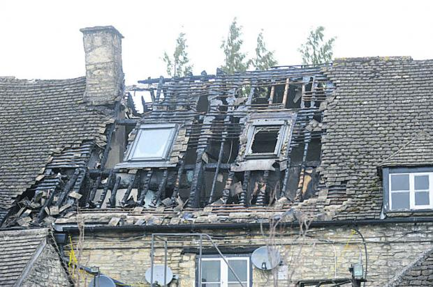 This Is Wiltshire: The badly-damaged roof of the Rattlebone Inn, Sherston, today