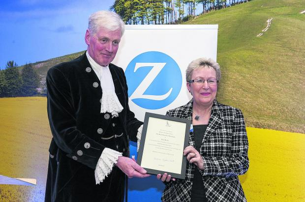 This Is Wiltshire: Pam Webb, receives the award from High Sheriff of Wiltshire William Wyldbore-Smith