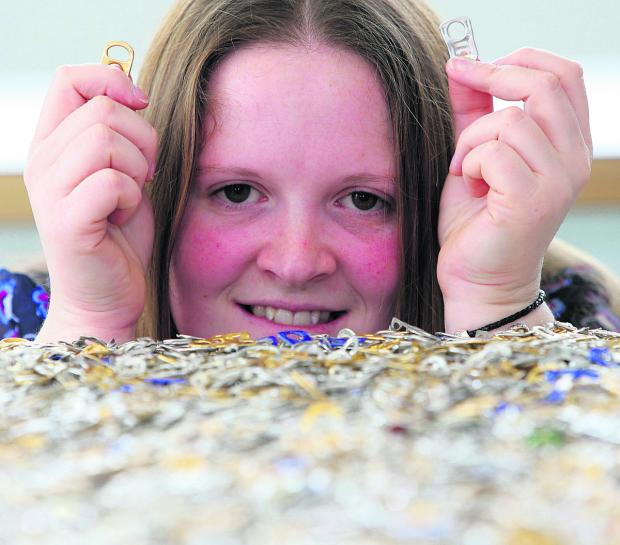 This Is Wiltshire: Suzanne McCarthy with some of the ring pulls collected by Openworks staff