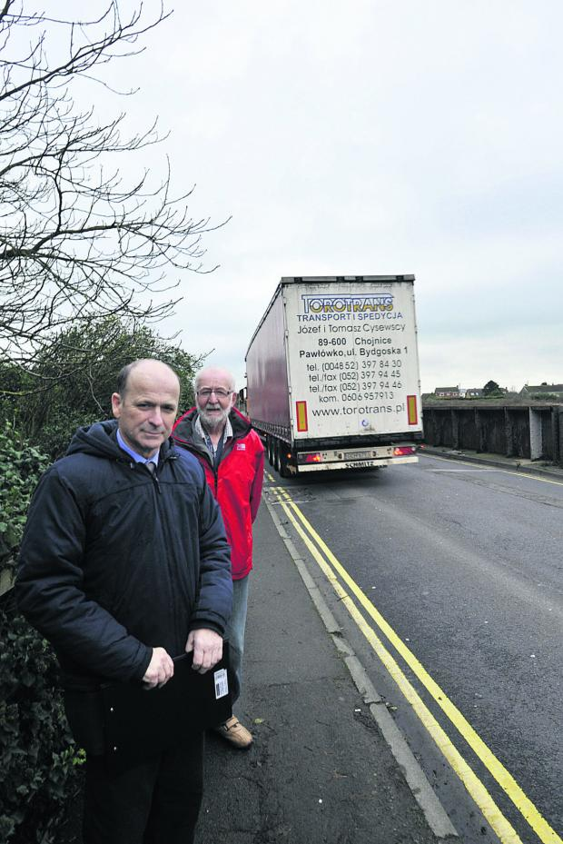 This Is Wiltshire: Cllr David Jenkins, front, and Primmers Place resident Clive Sutterly on Station Road railway bridge