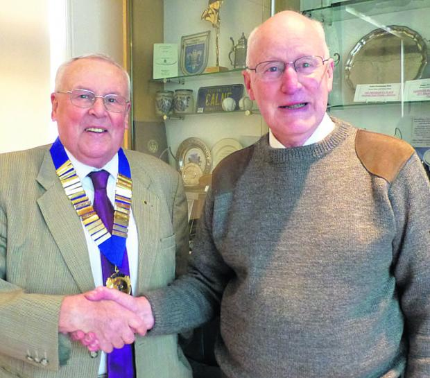 This Is Wiltshire: Calne Probus club president's badge is presented to Malcolm Smith, left, by the outgoing president Roger Walters