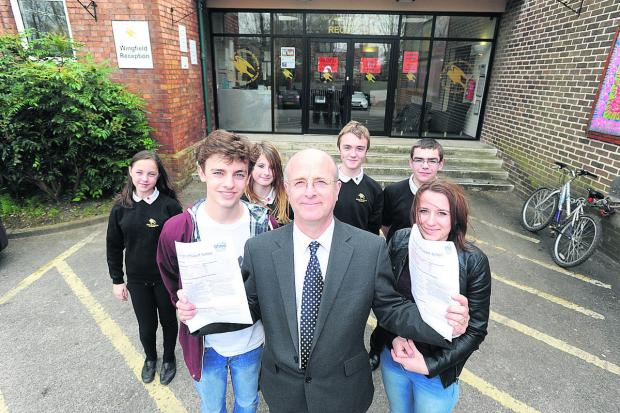 This Is Wiltshire: John of Gaunt headteacher Andy Packer celebrates the school's better ranking with sixth-formers Max and Olivia and pupils                                                                         Photo: Trevor Porter (48489)
