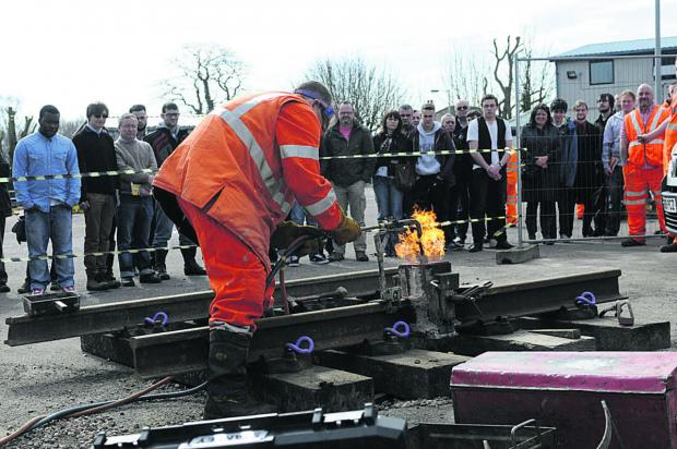 This Is Wiltshire: Network Rail staff demonstrate how stressed rails are replaced
