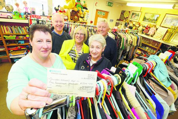 This Is Wiltshire: The Walcot Charity Shop presents a £500 cheque to the Women's Refuge. Pictured are Debra Estarbrook, Joe Haracz, Margaret B