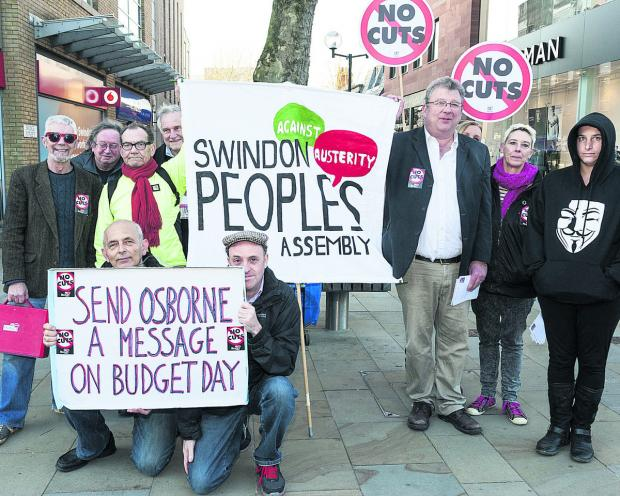 This Is Wiltshire: Protesters make their views known in Swindon town centre yesterday