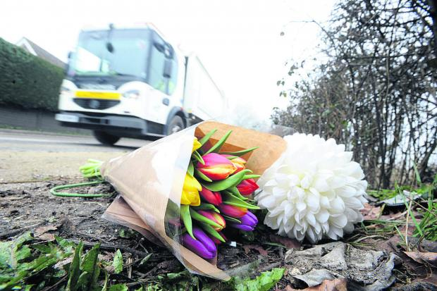 This Is Wiltshire: Flowers left at the scene on the A3102 near Calne where Tracey Rooke, 43, died last Thursday