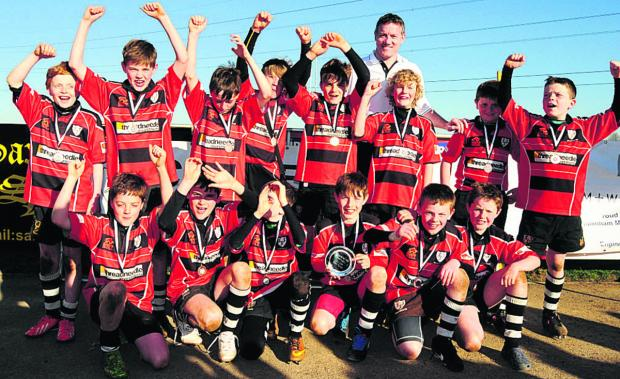 This Is Wiltshire: U11 Chief plate competition winners Chippenham Red (left) celebrate