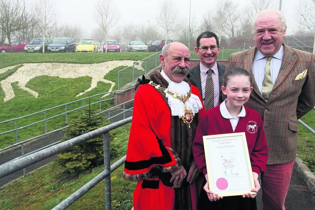 This Is Wiltshire: Harriet Dennis, of Nursteed Community Primary School, receiving her prize from Devizes mayor, Pete Smith, with head teacher Tim Heath and governor John Parker       (VS232) By VICKY SCIPIO