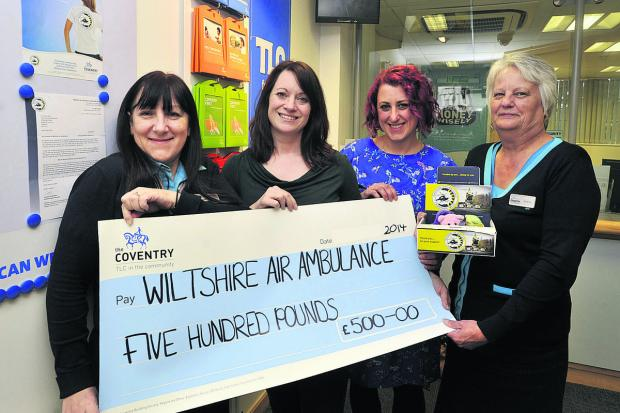 This Is Wiltshire: Karen Arter, left, and Andrea Evans of the Coventry Building Society and Claire Kelly and Rebecca de la Bedoyere,centre right, of Wlitshire Air Ambulance (49210)