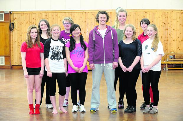 This Is Wiltshire: Actor Shaun McCourt with students lined up for the dance workshop at Lavington School
