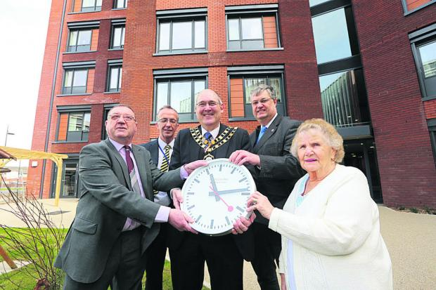 This Is Wiltshire: Officially opening Kimmerfields Court, are, from left, resident Gary Law, GreenSquare group chief executive Howard Toplis, mayor Nick Martin, council leader David Renard and resident Greta Moulding