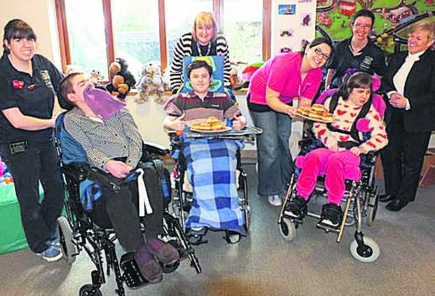 This Is Wiltshire: Staff and children at Naomi House hospice, which has been helped by Doughnut Week donations