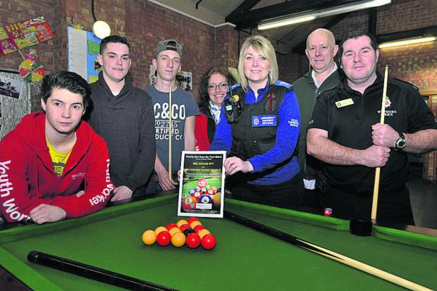 This Is Wiltshire: From left, Harry Jones, Jack Oatley, Chris Mepsted, Sue Warder, PCSO Helen Wilson, Mark Holden and PC Kane Fulbrook-Smith at a pool tournament for Sport Relief held at the Canberra Youth Centre