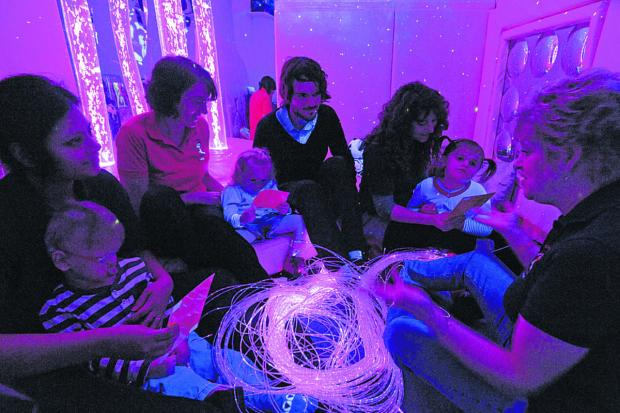 This Is Wiltshire: Reporter Craig Jones sits in on a sensory room session with, from left, Shrutai Kumar with Liam Collins, Judy Hennesy  with Mia Blaxall, Cally Pocock with Lydia Wadds, and session leader Gill Williams