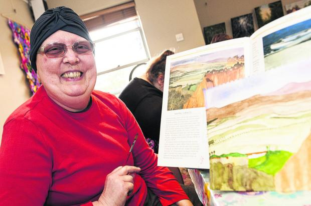 This Is Wiltshire: Hilary Stiles with a watercolour she painted. Picture: ALEX SKENNERTON