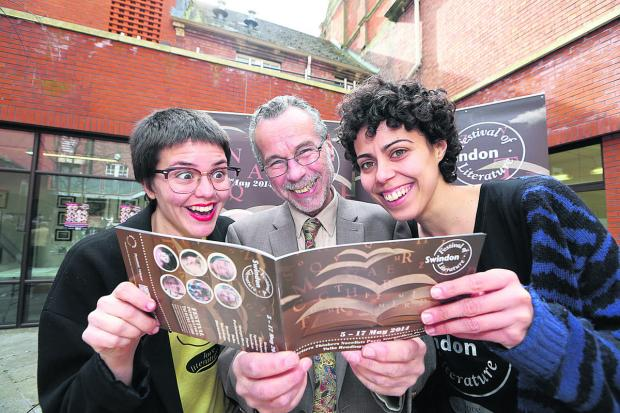 This Is Wiltshire: Launching the literature festival at the Central Library, organiser Matt Holland, centre, with festival helpers Nuria Cano and Maria Garvia Perez