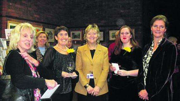 This Is Wiltshire: Left, Linda Blake, Warminster Art Society chairman, centre Yvonne Brunton of Dorothy House and right, Lady Silvy McQuiston, with some of the cast of the Calendar Girls production