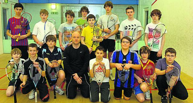 This Is Wiltshire: Wiltshire Squash's Dax Mellor (above, black top) with the Sports Stars youngsters     Picture by Paul Morris (PM1115-0)