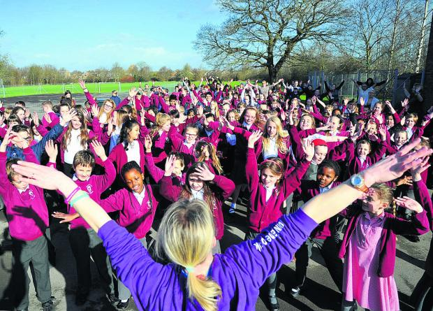 This Is Wiltshire: Covingham Park Primary School pupils take part in a Wake and Shake for Sport Relief. Picture: DAVE COX