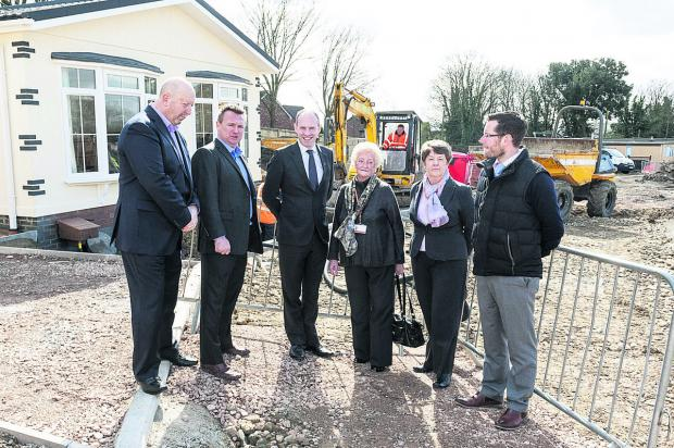 This Is Wiltshire: Discussing the work at the Blunsdon Abbey Park development, from left, Martin Clifton, of Homeseeker Park Homes, park owner Adam Griffin, Swindon North MP Justin Tomlinson, Vera Tomlinson, Mary Friend and park manager Nick Bond-Powell