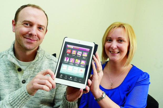 This Is Wiltshire: Lee and Michelle Stoddart show off the Big Local App Swindon service, which is being used to help raise awareness of domestic abuse