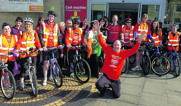 This Is Wiltshire: Staff at Sainsbury's, Calne, with store manager Craig Hussey centre, at the start of their ride to the Devizes store