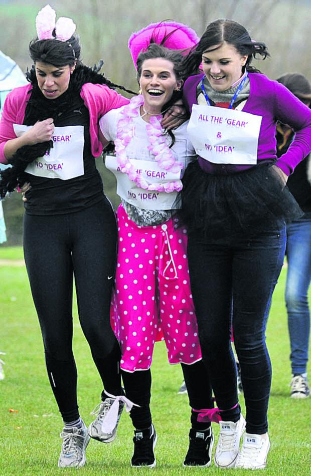 This Is Wiltshire: Melksham Oak School staff in the Sport Relief four-legged race