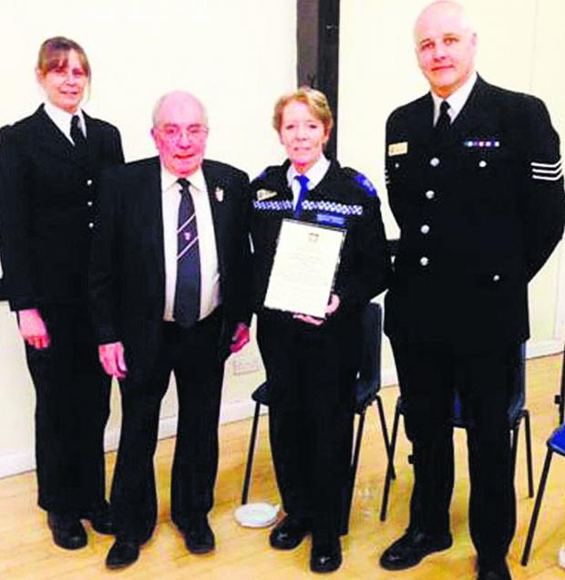 This Is Wiltshire: Sgt Martin Alvis accepts the award along with PC Rachel Webb, PCSO Dee Curran and former Malmesbury ma