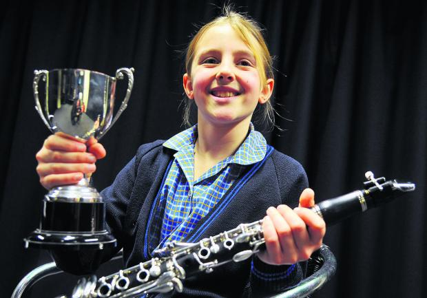 This Is Wiltshire: Tessa Harrison is all smiles after winning her class at the Swindon Music Festival