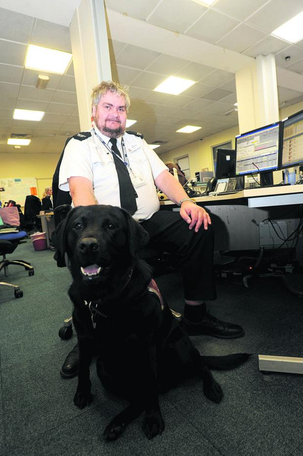 This Is Wiltshire: Call handler Mike Alexander with his guide dog Layla