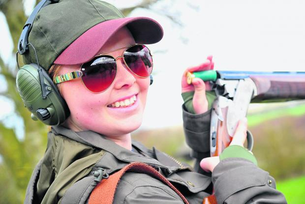 This Is Wiltshire: Amelia Garrett loads up at the charity clay pigeon shooting competition at Barbury Shooting School