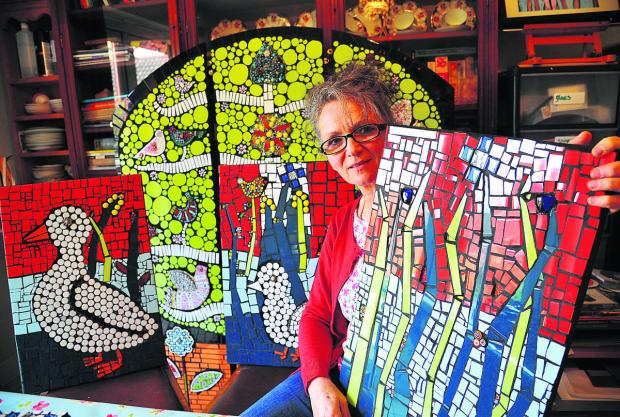 This Is Wiltshire: Kim Thomson with the new mosaic for Rosebank Care Home in Bampton