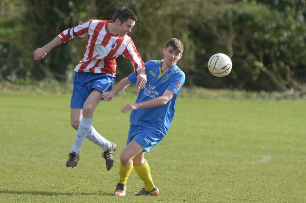 This Is Wiltshire: Wootton Bassett's Lewis Petrie and Intel's Zahn Jeffery in action at the weekend