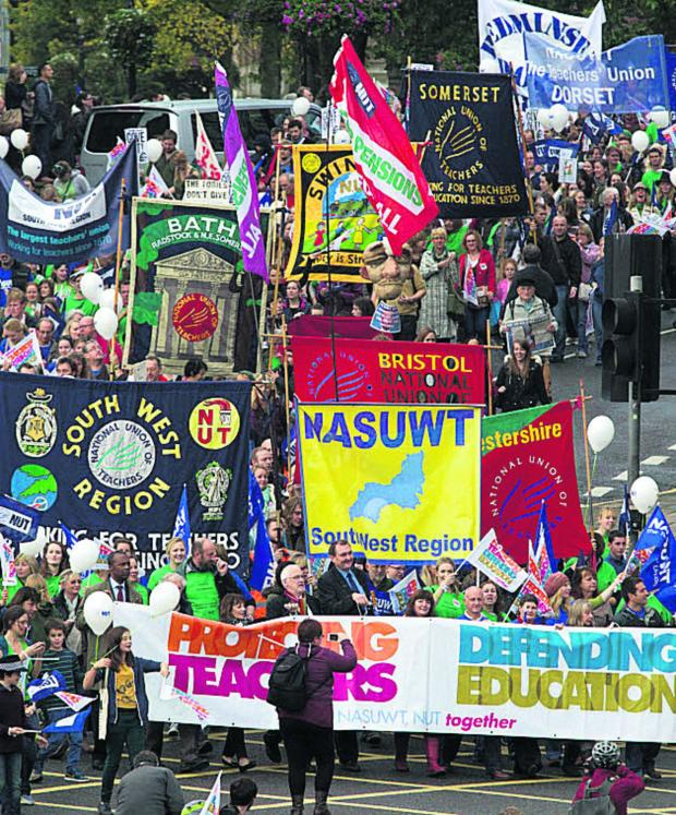 This Is Wiltshire: NUT members marching with NASUWT members in Bristol when they went on strike last October