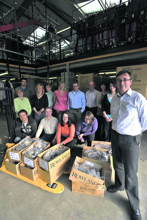 This Is Wiltshire: Director David Selby pictured with staff at the Southwick warehouse at the time of the 2012 buy-out