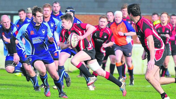 This Is Wiltshire: Bradford on Avon's Dan Bright sports a gap in the Supermarine defence on Saturday