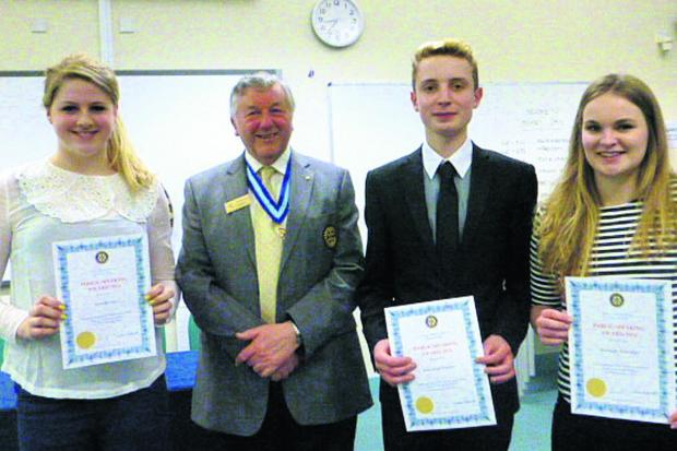 This Is Wiltshire: Hardenhuish School's Senior Youth team of Sara Bevan, Hannah Ashbridge and Sebastian Turner with Eric Sambel, past governor of Rotary District 1200